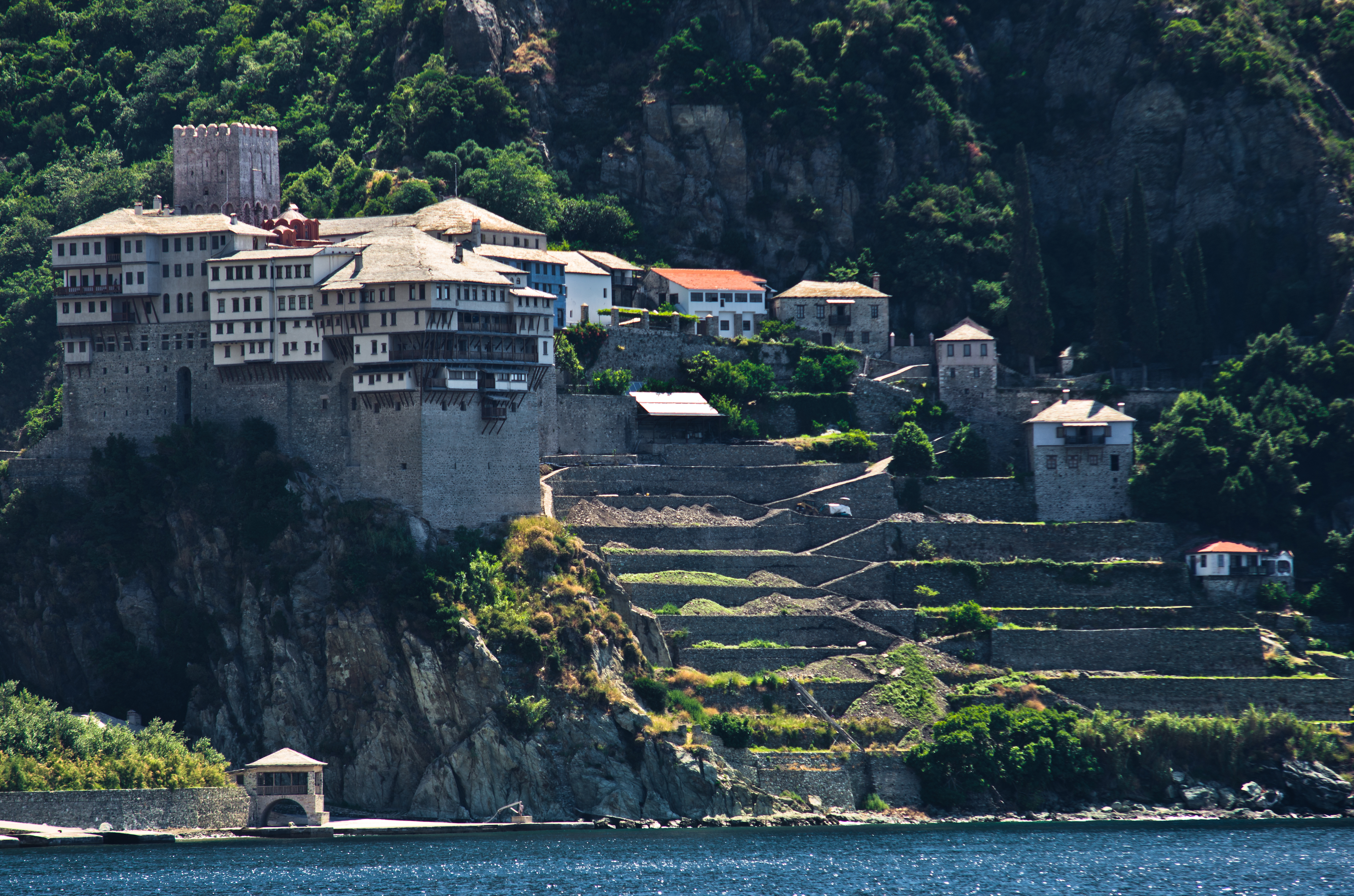Greek monastery on a coast of aegean sea below the holy mountain Athos in Greece
