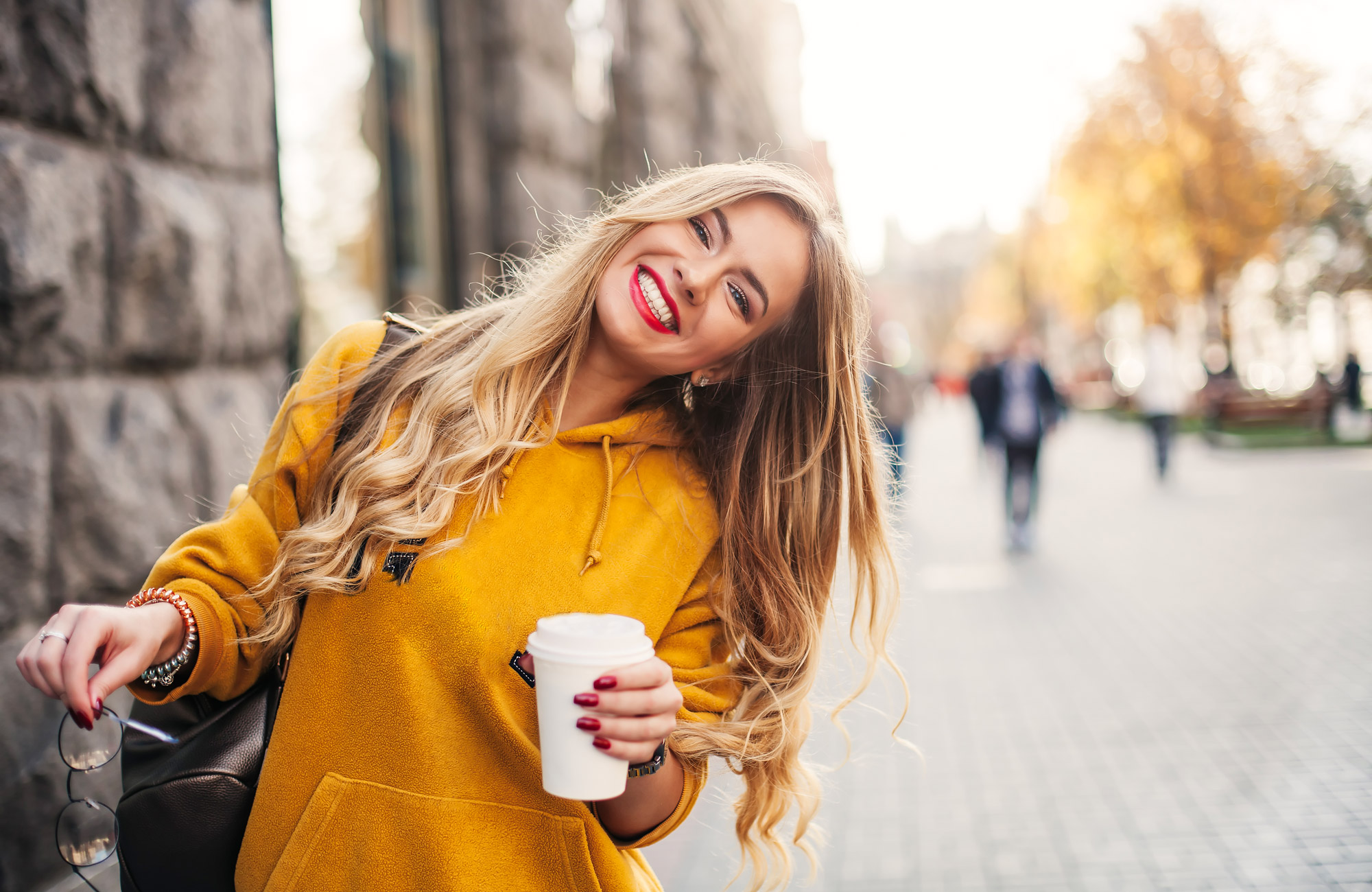 girl-coffee-yellow-jumper